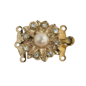 Vintage 3-strand fancy gold metal box clasp with a glass pearl encircled by pave rhinestones. 18mm. b8-363