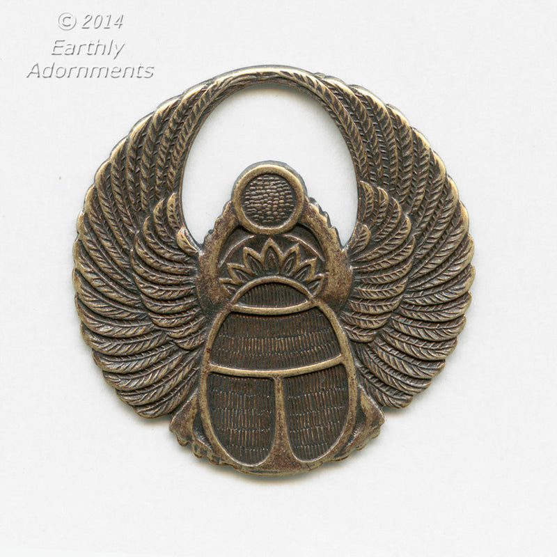 Oxidized brass winged scarab stamping 40 mm diameter. Sold individually. B9-2273-2