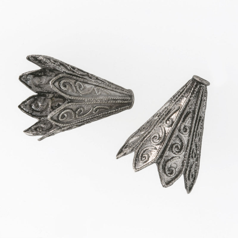 Finely decorated silver-plated cones. Sturdy and good quality. 20mm x14mm. Pkg. of 2. B9-0496