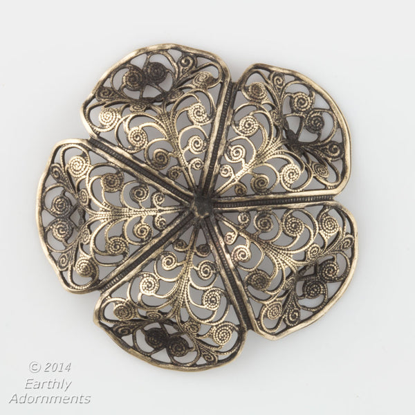 Oxidized brass filigree in a buttercup shape. 45x15mm Sold individually. b9-0575(e)