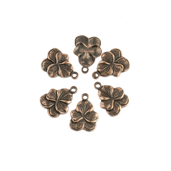 b9-0752-Stamped brass pansy charm. 8x10mm Pkg. of 6