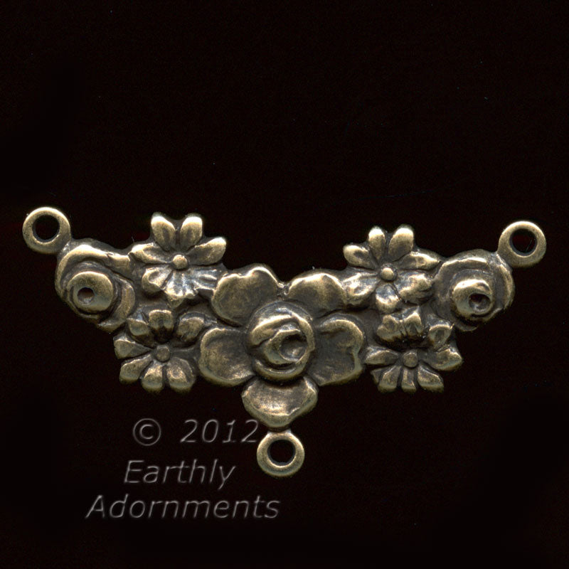 Oxidized stamped brass 3 ring connector in floral garland motif. 26mm x 10mm. Pkg. of 2. b9-0834