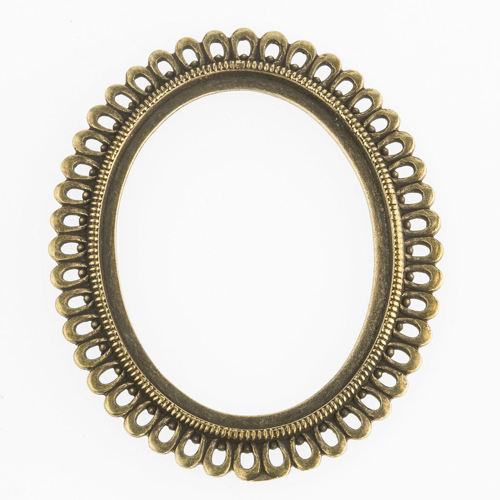 Vintage antiqued brass open back bezel for a 40x30mm cabochon. Scalloped ringed border. 1 pc. b9-0924