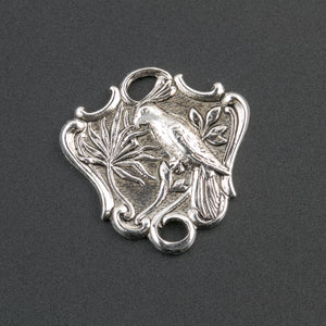Sterling silver plated brass 2 ring connector depicting a bird on a branch. Pkg. of 2. B9-2301s
