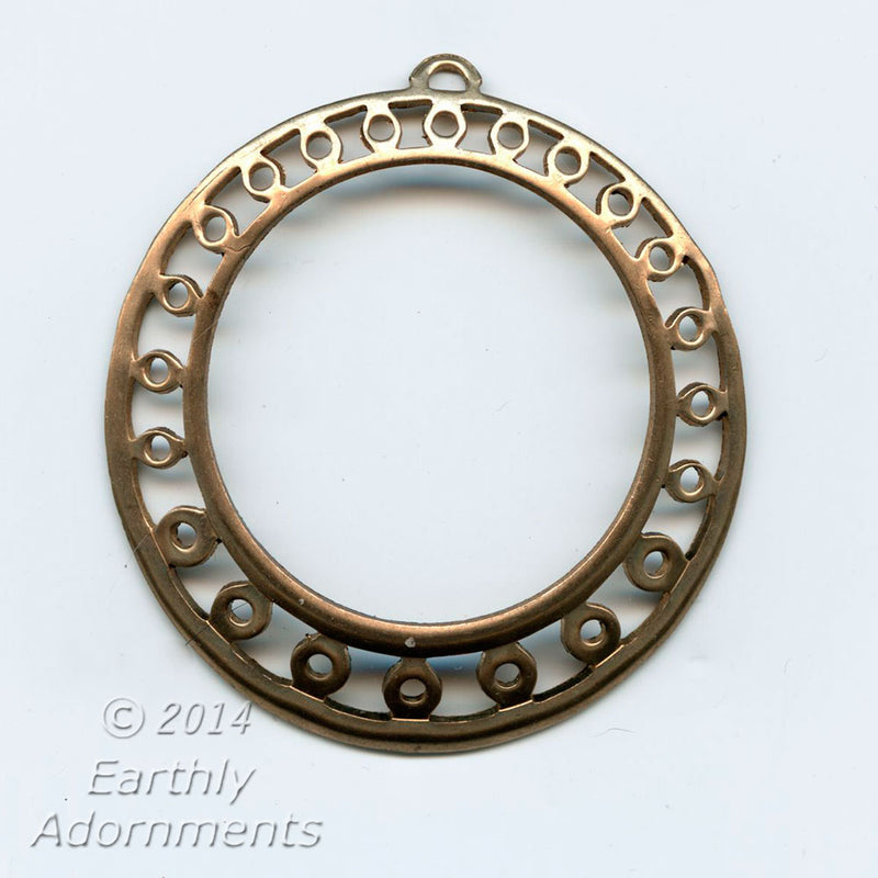 Stamped brass large decorative hoop slightly concave. 44mm. Sold