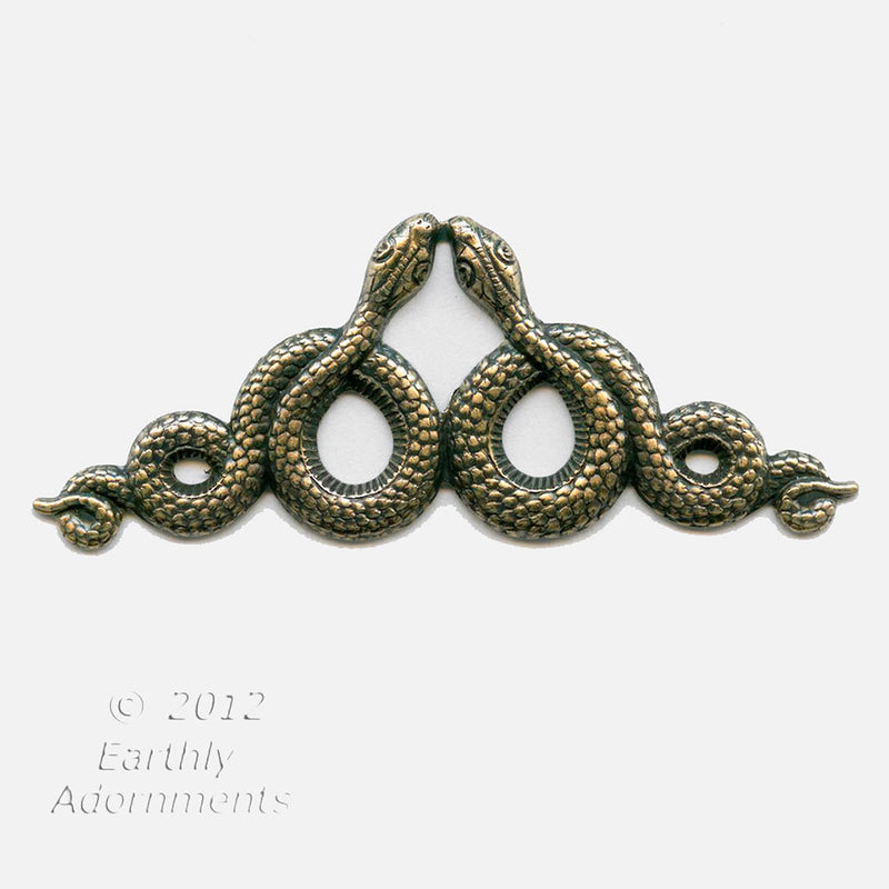 Oxidized brass serpent stamping. 68x26mm. Sold individually.