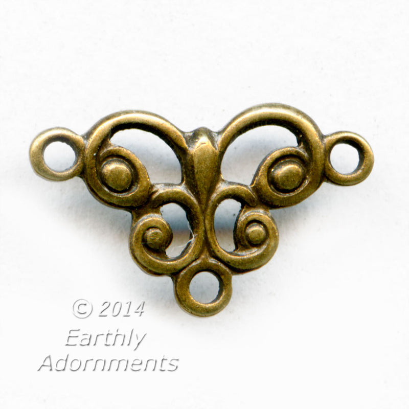 Oxidized brass stamped filigree 1 to 2 ring connector. 12x7mm.