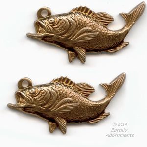 Red brass stamped fish charm. Measures 22x12mm. Package of 3. b9-2321