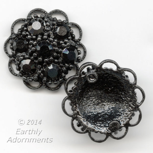 Cast black enameled domed rosette with jet glass cabochons. 23mm