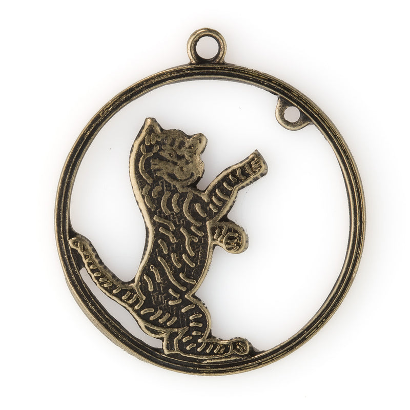 Stamped oxidized brass cat reaching for a ball inside hoop. 28x25mm. Package of 2. b9-2375(e)