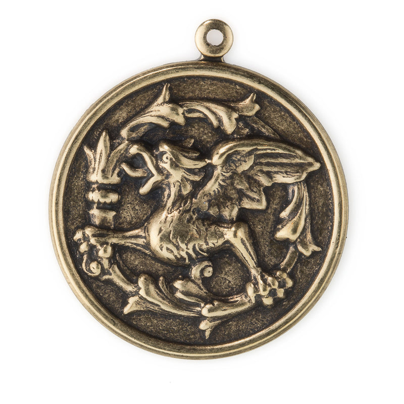Stamped oxidized brass repousse gryphon coin charm. 33x28mm. Package of 2. b9-2387(e)