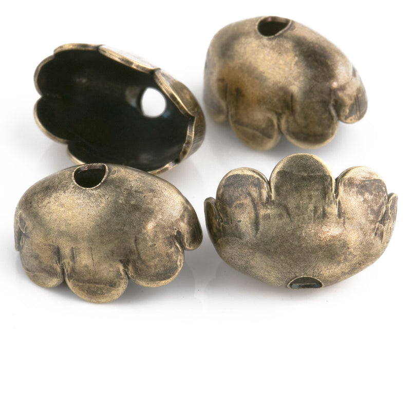 Oxidized brass 8 petal solid brass oval bead cap. 14x8x9mm. Pkg of 4. b9-2447
