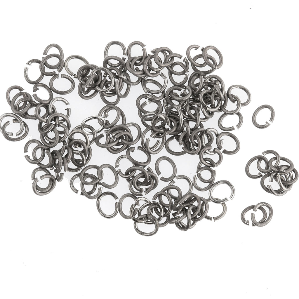 Vintage Oxidized silver plated 22 gauge 3.5mm oval open jump rings. Pkg 100.  b9-2470
