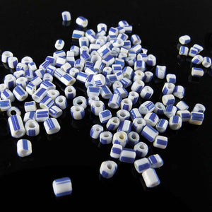 Antique Italian Hudson Bay seed beads 12/0 white with blue stripes. Mid 1800's. 15 gram bag. b17-160