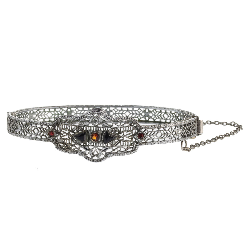 1930s Art Deco hinged rhodium filigree bangle bracelet with red and black glass stones. brad106