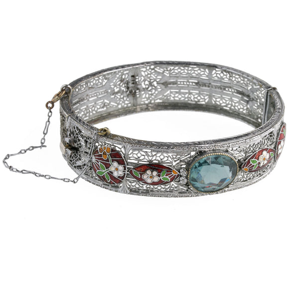 brad113(e)- Art Deco hinged rhodium filigree wide bangle bracelet with applied cloisonné decor and sapphire glass stone. c. 1930.