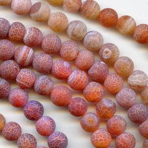 Sandblasted carnelian 15mm rounds pkg of 4. b4-car250-2