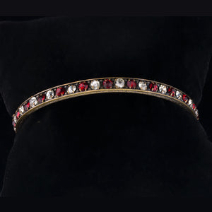 Vintage 1930's solid brass bangle bracelet with alternating clear and ruby red rhinestones.. brvn110