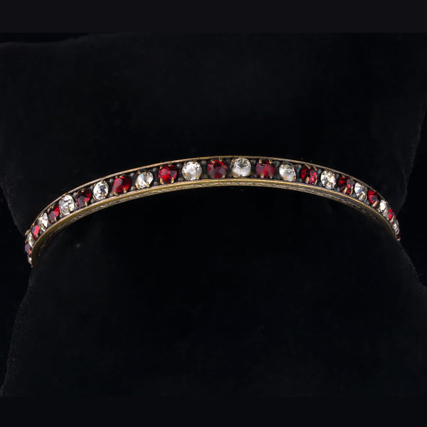 brvn110(e)- Vintage 1930's solid brass bangle bracelet with alternating clear and ruby red rhinestones.