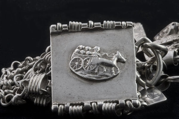 brvs870(e)-Antique 19th Century Dutch silver bracelet with charms. Hallmarked