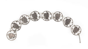 Antique cut out Barber dime love token bracelet. brvs951