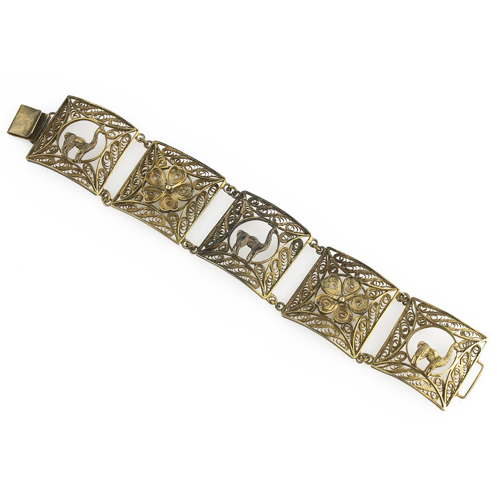 Vintage bracelet of silver vermeil goldwash filigree panels with llamas and rosettes. brvs954