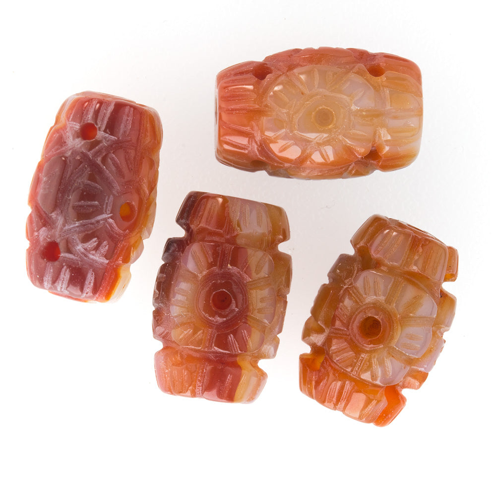 Hand carved pierced carnelian agate barrel beads. 18x12mm. Sold individually. b4-car306(e)
