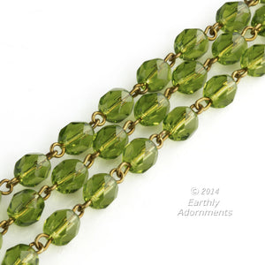 Czech chain of olivine green faceted glass beads and brass wire.