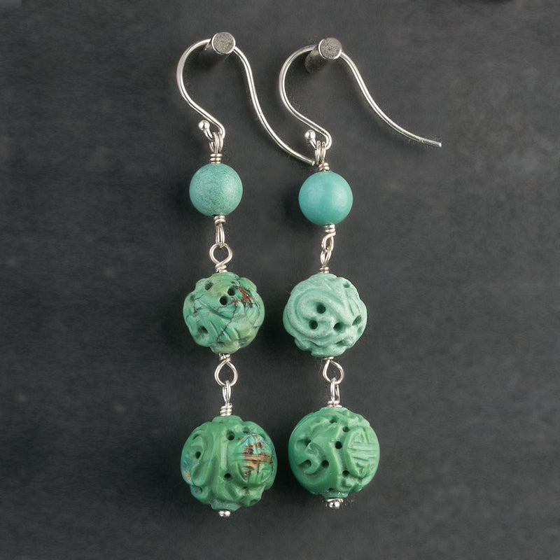 Vintage Chinese hand carved natural turquoise bead earrings. erbd137