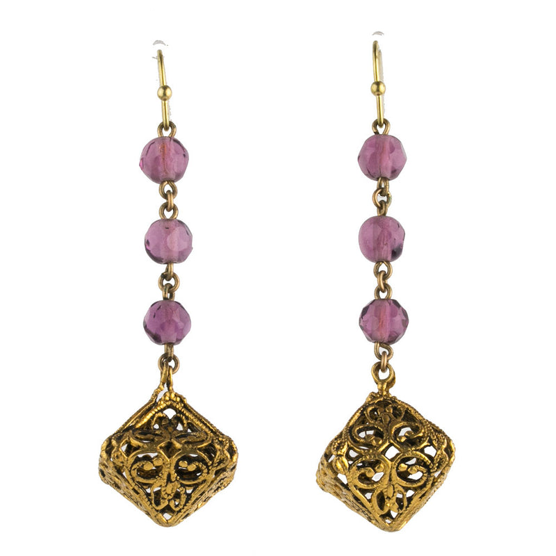 Vintage earrings of gilt filigree and amethyst glass beads on gold plated earwires. erbg854