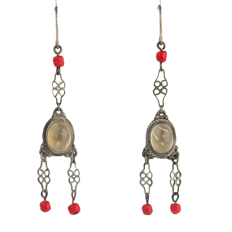 Chandelier earrings of vintage brass filigree, glass moonstone cabochon and tiny red beads. erbg860(e)