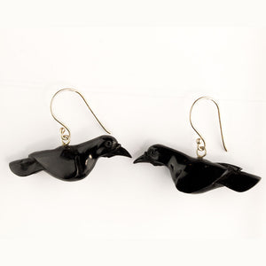 Carved buffalo horn raven earrings with sterling silver ear wires. erff943(e)