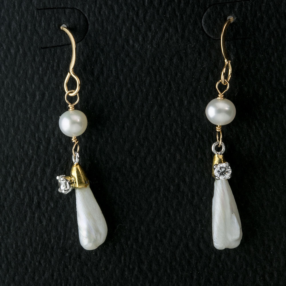 erfn118(e)- Vintage Mississippi pearl earrings with 15 point full cut diamonds on 14k gold wire.