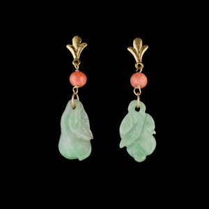 Earrings of antique carved green jade ornaments and antique coral beads. erja883