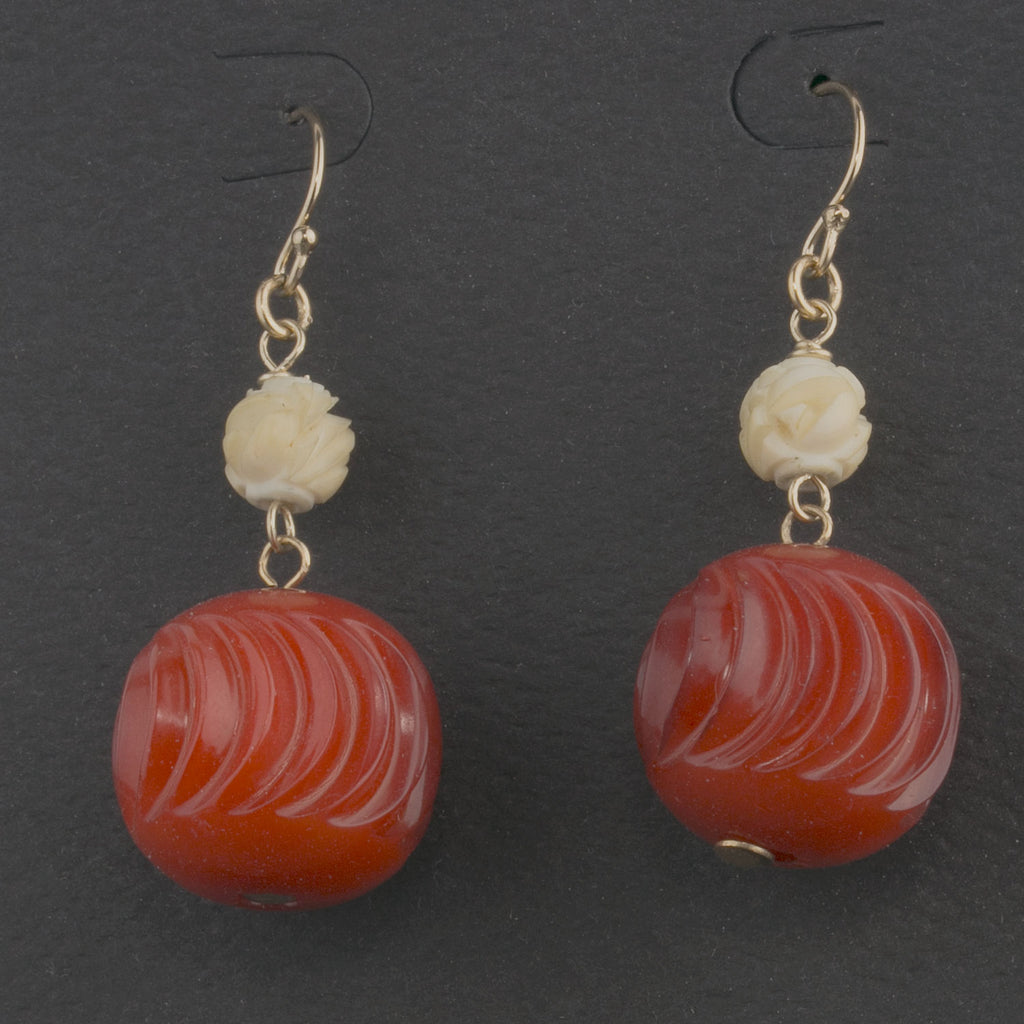 Earrings of vintage carved Galalith and carved rose bone beads. ervn950