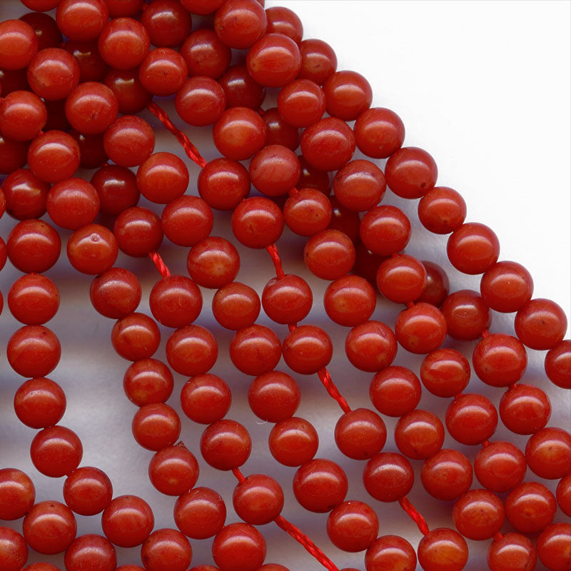 Color treated red bamboo coral 4mm rounds, package of 10. B4-cor370(e)