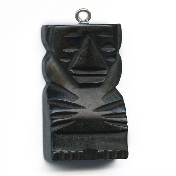 b7-wo262-1960s carved ebony Tiki pendant. 35x20mm sold individually.