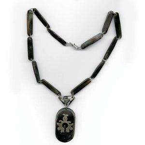 Vintage black horn pendant and necklace with silver overlay. nlvn694