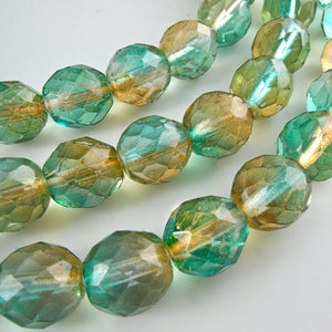 Firepolished 10mm faceted rounds, 2-tone in amber and aqua. Contemporary Czech. Package of 10. b11-mi-0163(e)