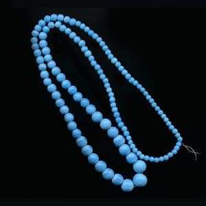 Vintage blue graduated 30 inch bead strand from India. b11-bl-1180(e)