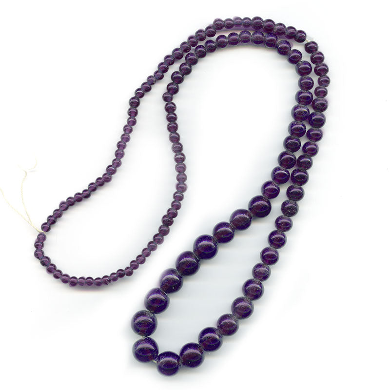 Vintage amethyst glass graduated 30 inch bead strand India. b11-pp-1059(e)