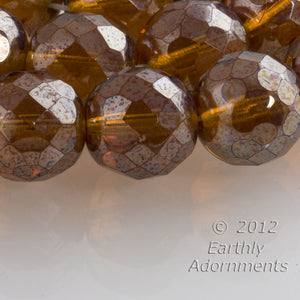 Contemporary Czech firepolish dark amber glass faceted rounds with partial silvered finish, 12mm, package of 10. b11-yo-0974(e)
