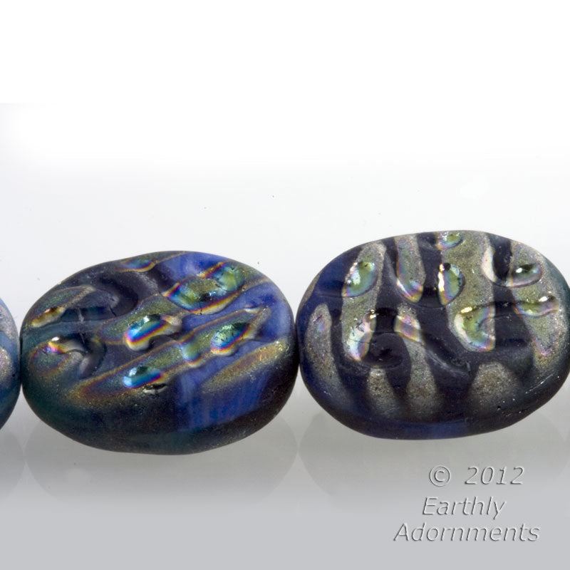 Gorgeous contemporary Czech flat pressed oval druk beads with a blue base and rainbow iridescent décor. 16x14x5mm, 4 pcs. b11-mi-1171(e)