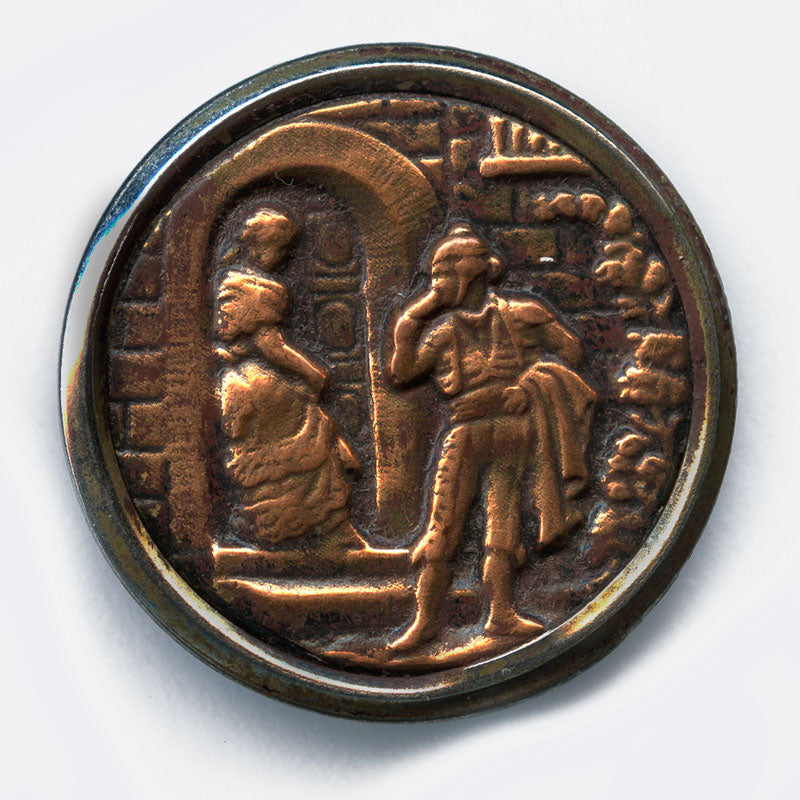 Antique stamped brass large picture button, man speaking to woman in doorway. 1.5 inches. btvc271