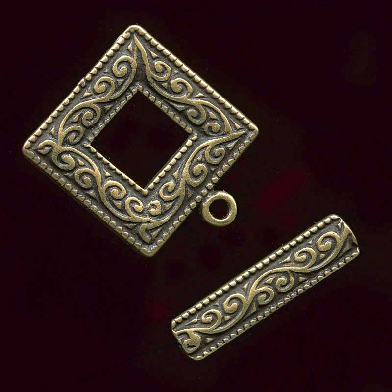 Square frame 2-part toggle clasp in an antique brass finish 18mm. Sold individually. b8-259