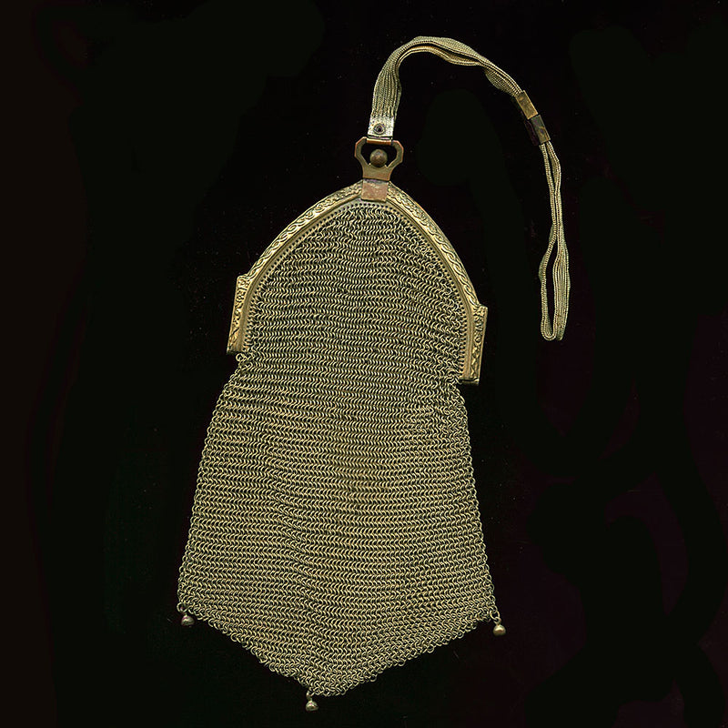1920s gold mesh dance bag with cathedral frame and scalloped bottom. hbad105