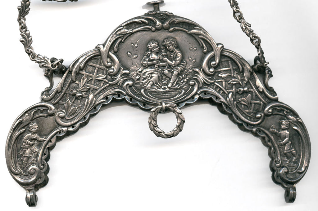 hbvc714(e)-Elaborate antique Victorian 800 silver purse frame.