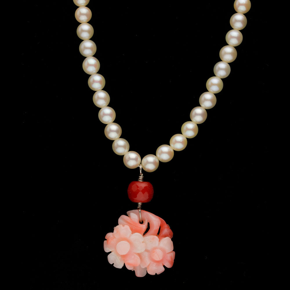 Estate Japanese Ocean Water Akoya 5mm pearl necklace with carved angel skin pendant. nlja878e