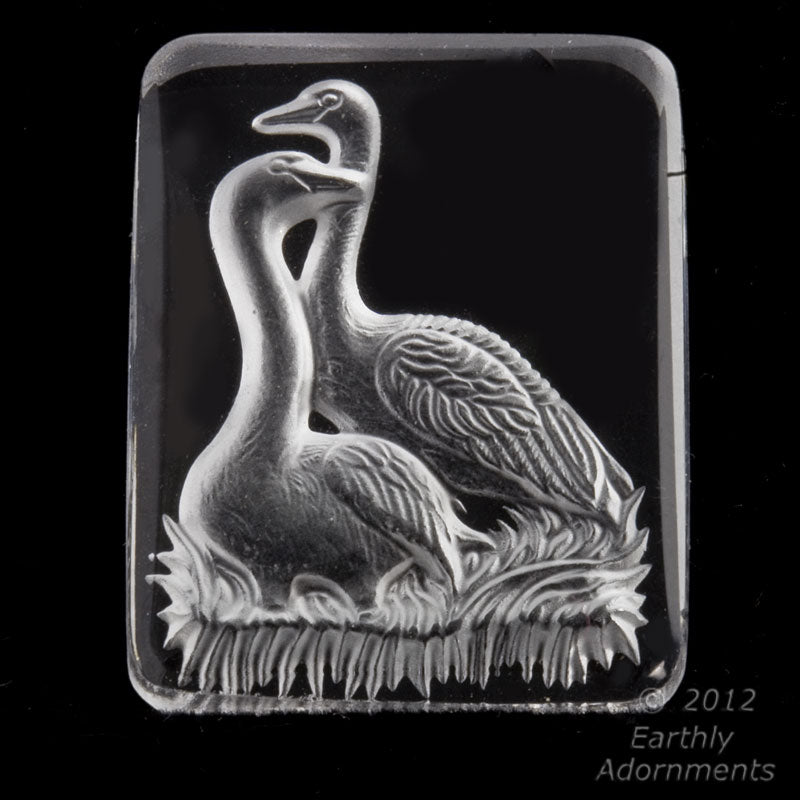 Vintage clear glass intaglio of two swans, carved on reverse and frosted. West Germany 34x25 mm. 1 piece. b5-828