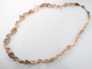 Vintage necklace of graduated and knotted red rutilated quartz large freeform beads. nlbd1133